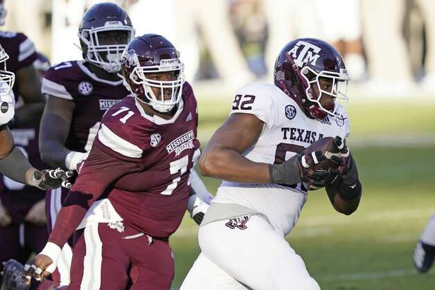Texas A&M defensive lineman Jayden Peevy (92) recovers a fumble and is pursued by Mississippi State offensive lineman James Jackson (71) during the second half of an NCAA college football game in Starkville, Miss., Saturday, Oct. 17, 2020. Peevy did not score. (AP Photo/Rogelio V. Solis) Photo: Rogelio V. Solis/Associated Press / Copyright 2020. The Associated Press. All rights reserved