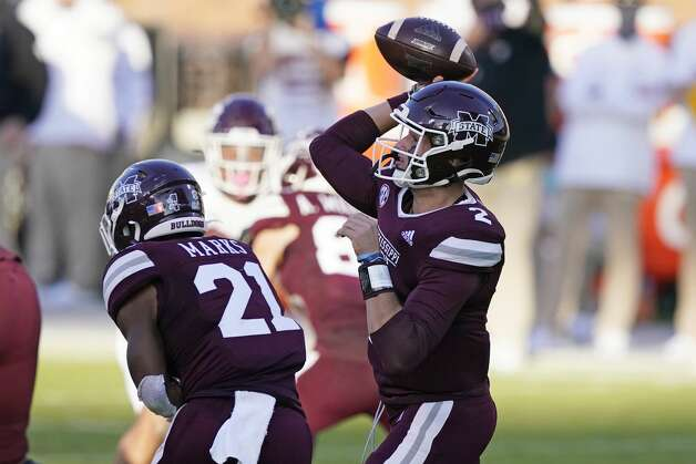 Mississippi State running back Jo'quavious Marks (21) blocks while quarterback Will Rogers (2) passes against Texas A&M during the second half of an NCAA college football game in Starkville, Miss., Saturday, Oct. 17, 2020. (AP Photo/Rogelio V. Solis) Photo: Rogelio V. Solis/Associated Press / Copyright 2020. The Associated Press. All rights reserved