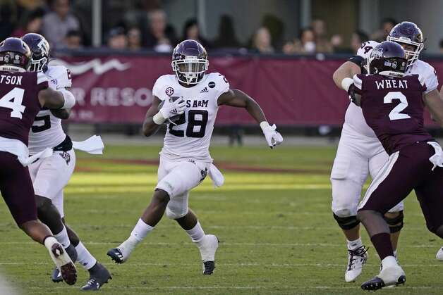 Texas A&M running back Isaiah Spiller (28) runs upfield past Mississippi State linebacker Tyrus Wheat (2) during the second half of an NCAA college football game in Starkville, Miss., Saturday, Oct. 17, 2020. (AP Photo/Rogelio V. Solis) Photo: Rogelio V. Solis/Associated Press / Copyright 2020. The Associated Press. All rights reserved