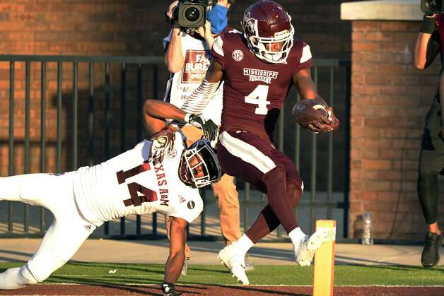 Mississippi State wide receiver Malik Heath (4) skips into the end zone after evading a tackle attempt by Texas A&M defensive back Keldrick Carper (14) during the second half of an NCAA college football game in Starkville, Miss., Saturday, Oct. 17, 2020. (AP Photo/Rogelio V. Solis) Photo: Rogelio V. Solis/Associated Press / Copyright 2020. The Associated Press. All rights reserved