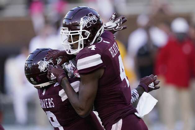 Mississippi State wide receiver Malik Heath (4) left, celebrates his 32-yard touchdown pass reception with a teammate during the second half of an NCAA college football game against Texas A&M in Starkville, Miss., Saturday, Oct. 17, 2020. (AP Photo/Rogelio V. Solis) Photo: Rogelio V. Solis/Associated Press / Copyright 2020. The Associated Press. All rights reserved