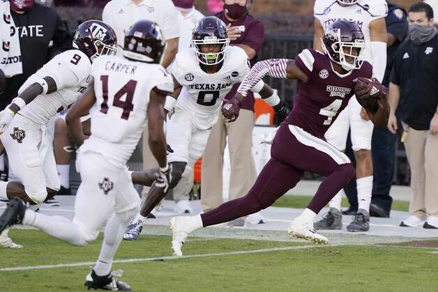 Mississippi State wide receiver Malik Heath (4) evades a host of Texas A&M defenders on his way to a 32-yard touchdown pass reception during the second half of an NCAA college football game in Starkville, Miss., Saturday, Oct. 17, 2020. (AP Photo/Rogelio V. Solis) Photo: Rogelio V. Solis/Associated Press / Copyright 2020. The Associated Press. All rights reserved