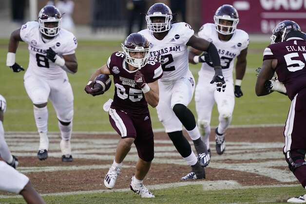 Texas A&M defenders run after Mississippi State wide receiver Austin Williams (85) as he heads upfield with a first down pass reception during the second half of an NCAA college football game in Starkville, Miss., Saturday, Oct. 17, 2020. (AP Photo/Rogelio V. Solis) Photo: Rogelio V. Solis/Associated Press / Copyright 2020. The Associated Press. All rights reserved