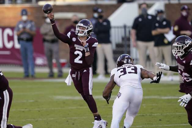 Mississippi State quarterback Will Rogers (2) passes under pressure from Texas A&M linebacker Aaron Hansford (33) during the second half of an NCAA college football game in Starkville, Miss., Saturday, Oct. 17, 2020. (AP Photo/Rogelio V. Solis) Photo: Rogelio V. Solis/Associated Press / Copyright 2020. The Associated Press. All rights reserved