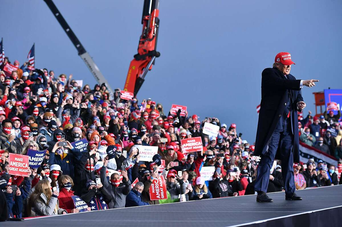 President Donald Trump gestures to supporters during a rally at Muskegon County Airport in Muskegon, Mich., on Oct. 17, 2020.