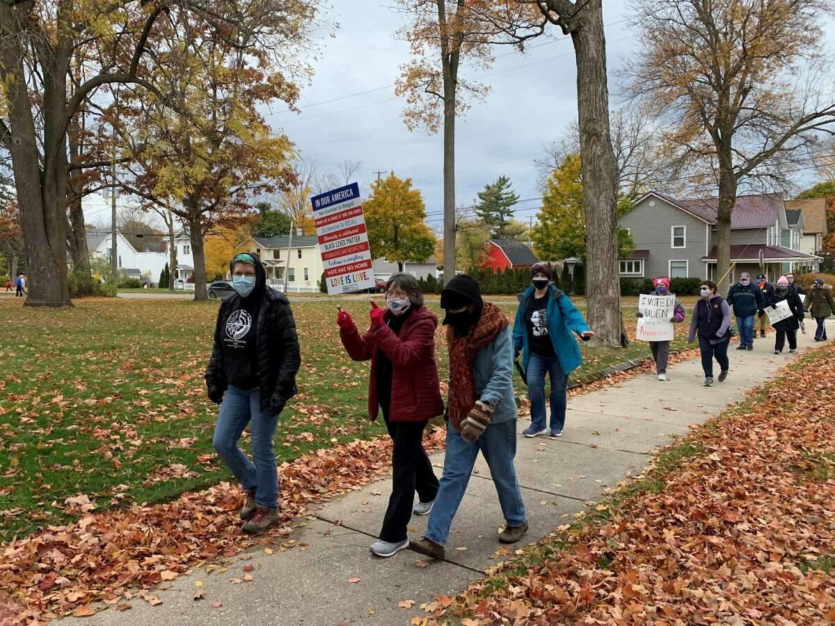Women, men, and even some children gathered at Mitchell Creek Park on Saturday for the Women's March Big Rapids. The march was coordinated to occur at the same time as hundreds of women's marches across the country in honor of Justice Ruth Bader Ginsburg.