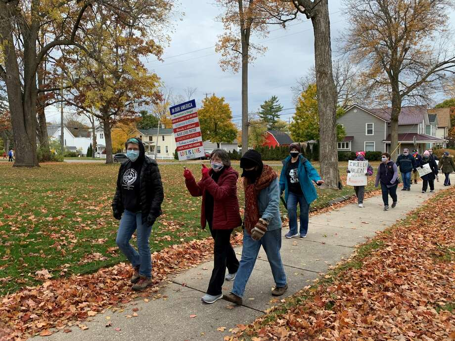 Women, men, and even some children gathered at Mitchell Creek Park on Saturday for the Women's March Big Rapids. The march was coordinated to occur at the same time as hundreds of women's marches across the country in honor of Justice Ruth Bader Ginsburg. Photo: Pioneer Photo/Cathie Crew