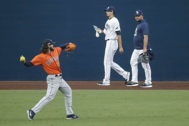 Houston Astros starter Lance McCullers Jr., left, warms up in the outfield as Tampa Bay Rays starter Charlie Morton (50) walks to the bullpen before Game 7 of the American League Championship Series at Petco Park Saturday, Oct. 17, 2020, in San Diego. Photo: Karen Warren/Staff Photographer / © 2020 Houston Chronicle