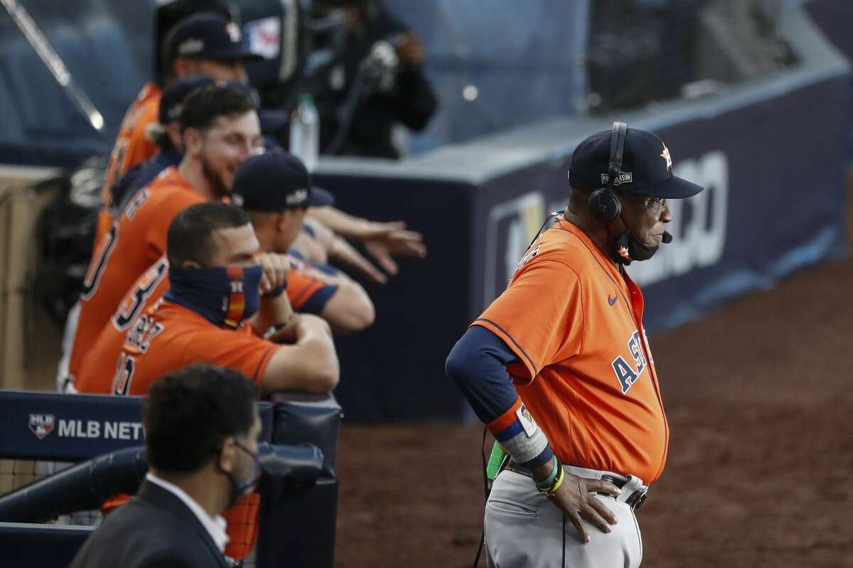 Houston Astros manager Dusty Baker, Jr., stands outside the dugout for a television interview before Game 7 of the American League Championship Series against the Tampa Bay Rays at Petco Park Saturday, Oct. 17, 2020, in San Diego.