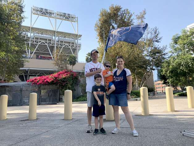 The Reichling family, Eric, Jamie with sons Hudson, 6, and Asher, 3, stand near the entrance to Petco Park, looking to see if there was some way to see the game from a vantage point or hang out with other Astros fans before the start of Game 7 of the American League Championship Series at Petco Park, Saturday, October 17, 2020, in San Diego. Photo: Karen Warren/Staff Photographer / © 2020 Houston Chronicle