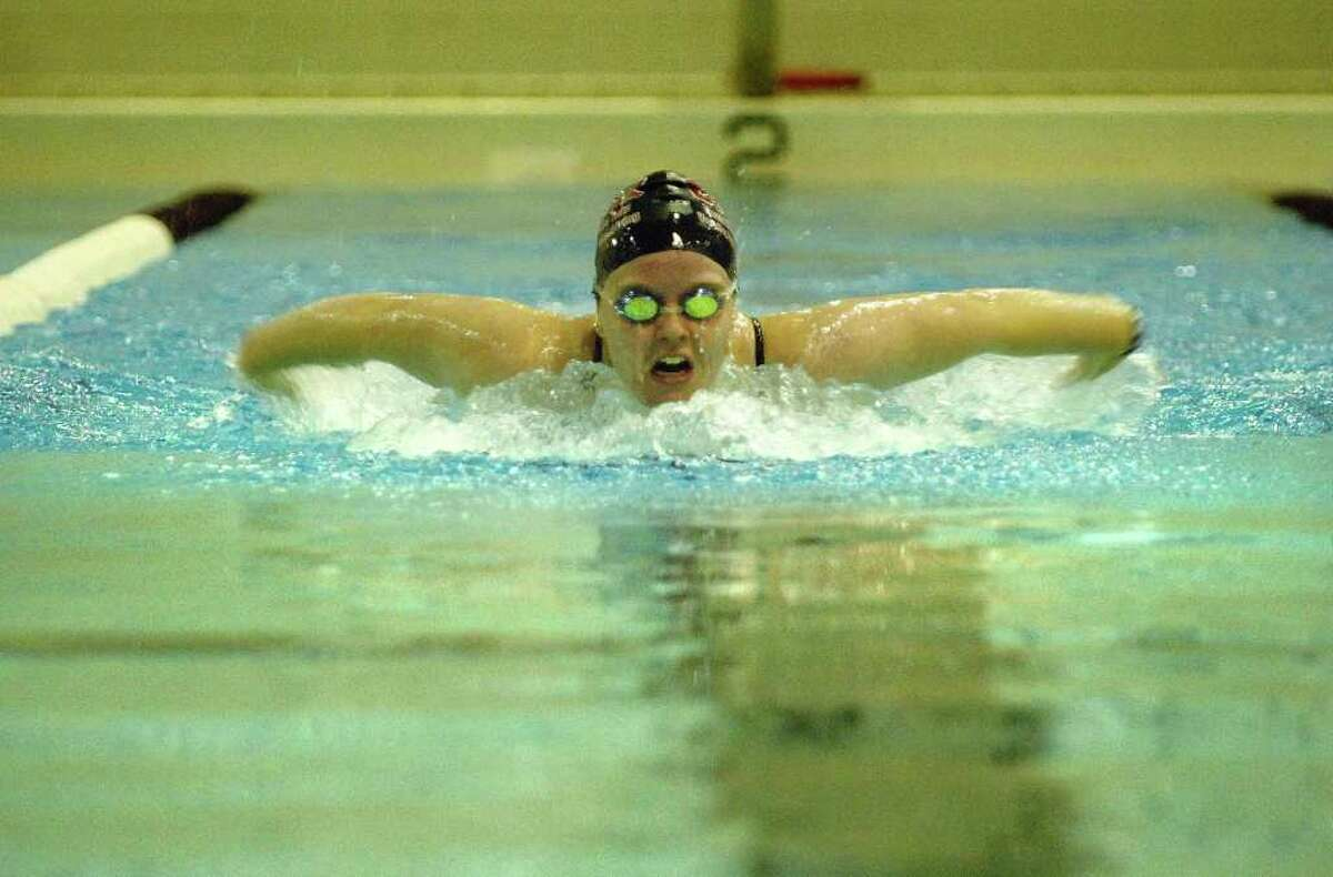 High school fall sports - Senior Emily Dreisbach performs the butterfly during girls' swim team practice at Burnt Hills-Ballston Lake High School in Burnt Hills on Wednesday, Aug. 25. The team has won four straight Class B sectional titles. (Paul Buckowski / Times Union)