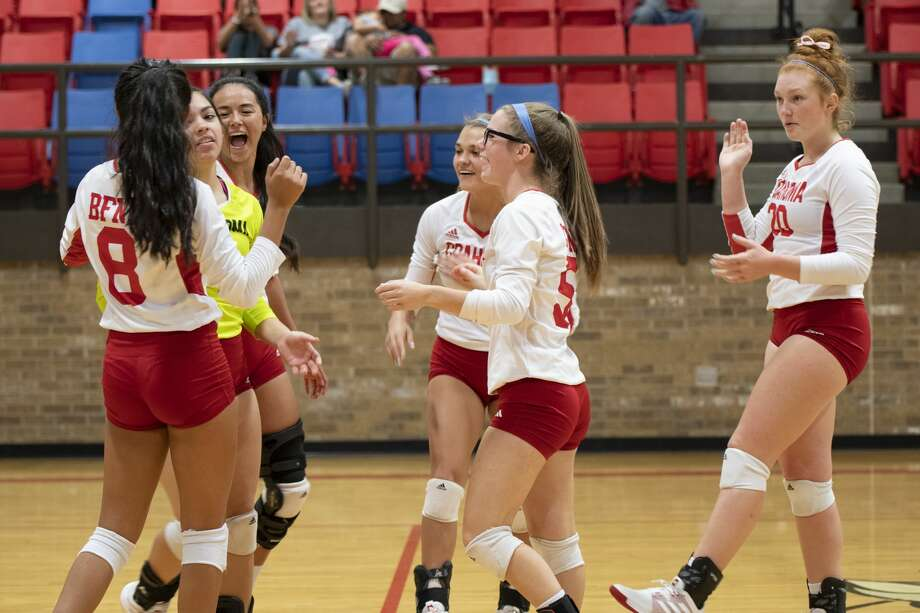 The Bulldogettes celebrate after libero Kenzi Canales, second from left, records an ace during the 5-3A district matchup against Odessa Compass Academy on Saturday.