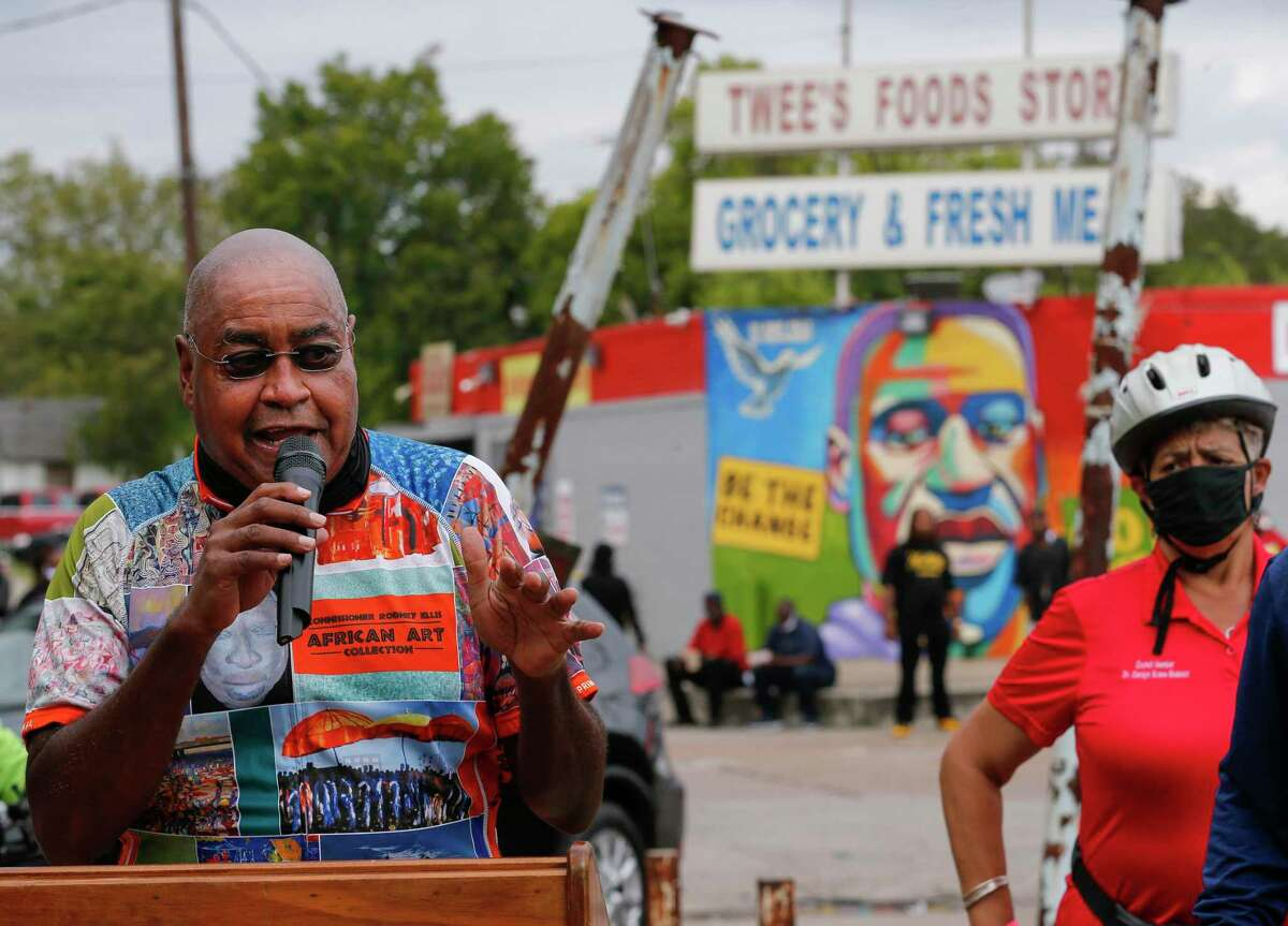 Commissioner Rodney Ellis, who sponsored a 1991 bill to remove the term 'Negro' from location names in Texas, talks to the crowd after a bike ride in honor of George Floyd's birthday, on Saturday, Oct. 17, 2020, in Third Ward, Houston. Floyd, a former Houston resident, was killed by a Minnesota Police officer earlier this year, leading to nationwide protests.