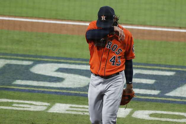 Houston Astros Lance McCullers Jr. (43) wipes his brow as he walks off the field at the end of the second inning against the Tampa Bay Rays in Game 7 of the American League Championship Series at Petco Park Saturday, Oct. 17, 2020, in San Diego. Photo: Karen Warren/Staff Photographer / © 2020 Houston Chronicle