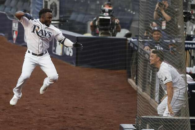 Tampa Bay Rays Randy Arozarena leaps in the air toward Willy Adames as he celebrates his 2-run home run hit off Houston Astros Lance McCullers Jr. during the first inning of Game 7 of the American League Championship Series at Petco Park Saturday, Oct. 17, 2020, in San Diego. Photo: Karen Warren/Staff Photographer / © 2020 Houston Chronicle