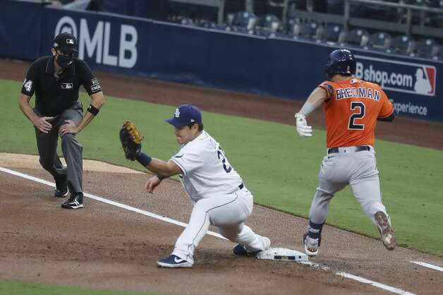 Tampa Bay Rays first baseman Ji-Man Choi stretches to make the play on Houston Astros Alex Bregman (2) at first during the second inning of Game 7 of the American League Championship Series at Petco Park Saturday, Oct. 17, 2020, in San Diego. Photo: Karen Warren/Staff Photographer / © 2020 Houston Chronicle