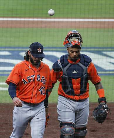 Houston Astros Lance McCullers Jr. (43) and catcher Martin Maldonado (15) walk off the field after getting out of the first inning against the Tampa Bay Rays in Game 7 of the American League Championship Series at Petco Park Saturday, Oct. 17, 2020, in San Diego. Photo: Karen Warren/Staff Photographer / © 2020 Houston Chronicle