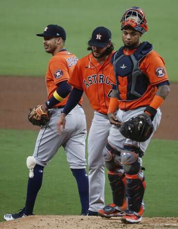 Houston Astros Carlos Correa, left, and Astros catcher Martin Maldonado (15) walk off the mound after talking to starting pitcher Lance McCullers Jr. (43) after McCullers gave up a solo home run to Tampa Bay Rays Mike Zunino during the second inning of Game 7 of the American League Championship Series at Petco Park Saturday, Oct. 17, 2020, in San Diego. Photo: Karen Warren/Staff Photographer / © 2020 Houston Chronicle