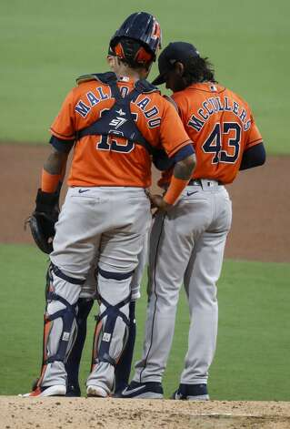 Houston Astros Martin Maldonado (15) talks to starting pitcher Lance McCullers Jr. (43) after McCullers gave up a solo home run to Tampa Bay Rays Mike Zunino during the second inning of Game 7 of the American League Championship Series at Petco Park Saturday, Oct. 17, 2020, in San Diego. Photo: Karen Warren/Staff Photographer / © 2020 Houston Chronicle