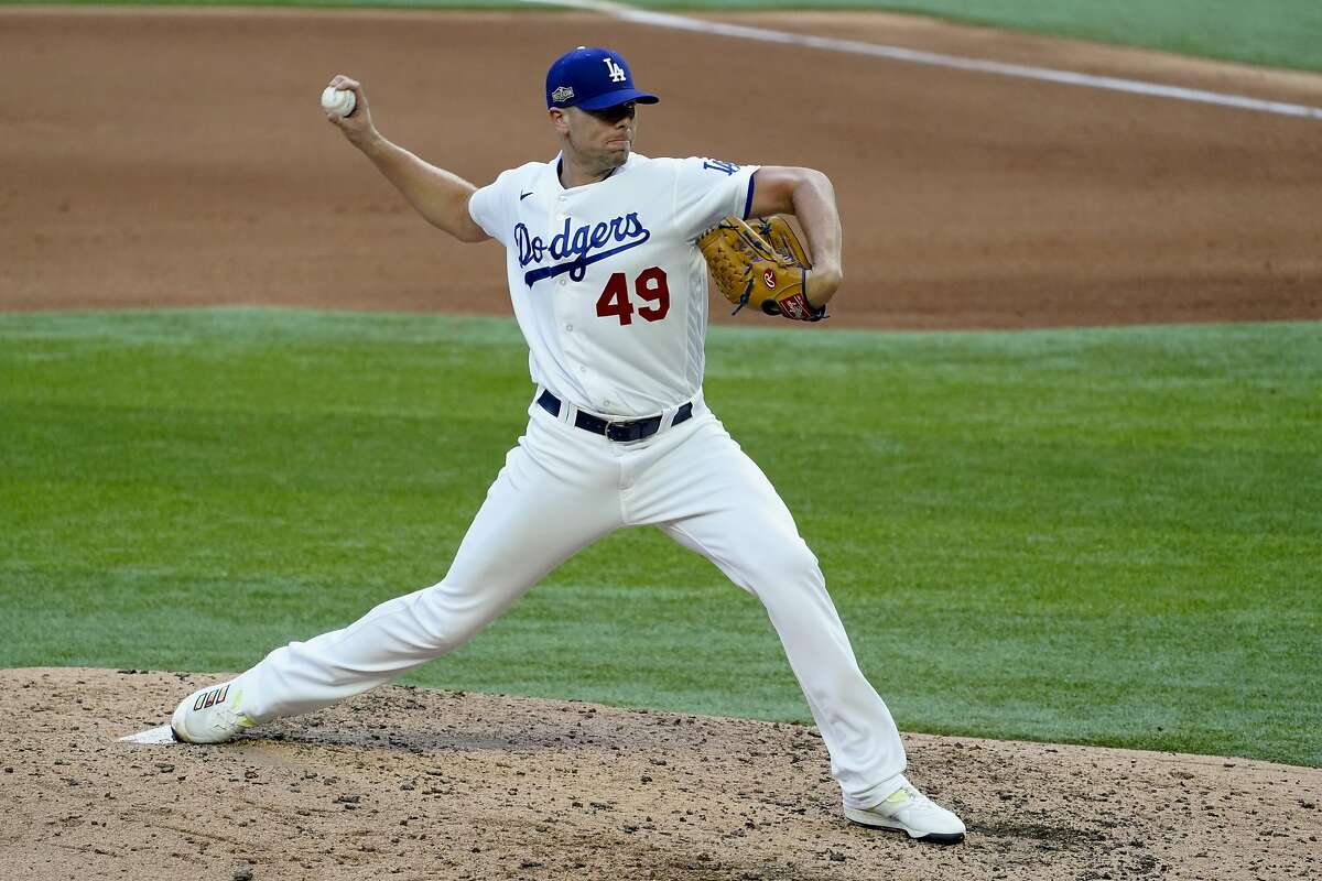 Los Angeles Dodgers relief pitcher Blake Treinen throws against the Atlanta Braves during the seventh inning in Game 6 of a baseball National League Championship Series Saturday, Oct. 17, 2020, in Arlington, Texas.