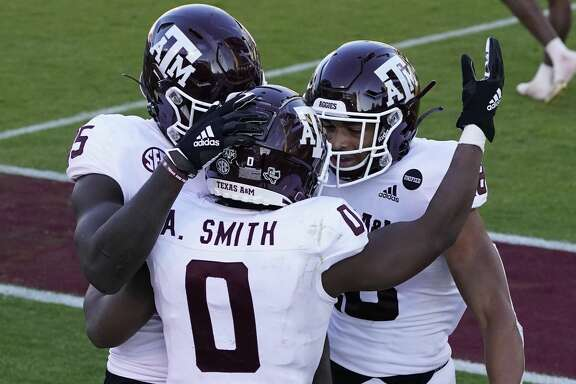 Texas A&M running back Ainias Smith (0) celebrates his 6-yard touchdown pass reception against Mississippi State with teammates during the second half of an NCAA college football game in Starkville, Miss., Saturday, Oct. 17, 2020. (AP Photo/Rogelio V. Solis)