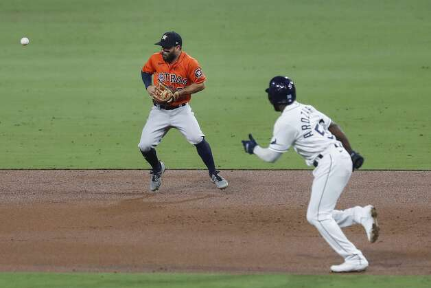 A grounder by Tampa Bay Rays Austin Meadows bounces off the glove of Houston Astros Jose Altuve (27) as Randy Arozarena (56) runs to second during the third inning of Game 7 of the American League Championship Series at Petco Park Saturday, Oct. 17, 2020, in San Diego. Altuve recovered to throw Arozarena out at second on the play. Photo: Karen Warren/Staff Photographer / © 2020 Houston Chronicle