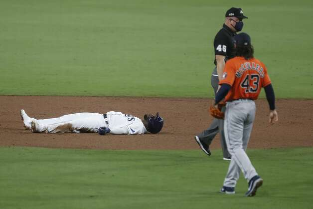 Tampa Bay Rays Randy Arozarena lies on the field after he was called out on a close play at second on a throw by Houston Astros second baseman Jose Altuve during the third inning of Game 7 of the American League Championship Series at Petco Park Saturday, Oct. 17, 2020, in San Diego. Photo: Karen Warren/Staff Photographer / © 2020 Houston Chronicle
