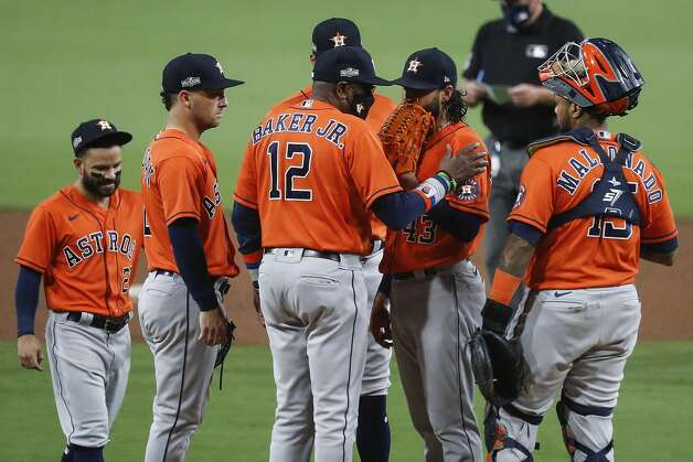 Houston Astros manager Dusty Baker, Jr., (12) talks to starter Lance McCullers Jr. (43) just before taking him from the game against the Tampa Bay Rays during the fourth inning of Game 7 of the American League Championship Series at Petco Park Saturday, Oct. 17, 2020, in San Diego. Photo: Karen Warren/Staff Photographer / © 2020 Houston Chronicle