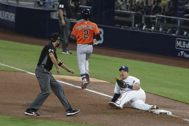 Tampa Bay Rays Ji-Man Choi lies on the field after making a stretch to complete the out on a grounder by Houston Astros Alex Bregman (2) during the fifth inning of Game 7 of the American League Championship Series at Petco Park Saturday, Oct. 17, 2020, in San Diego. Photo: Karen Warren/Staff Photographer / © 2020 Houston Chronicle