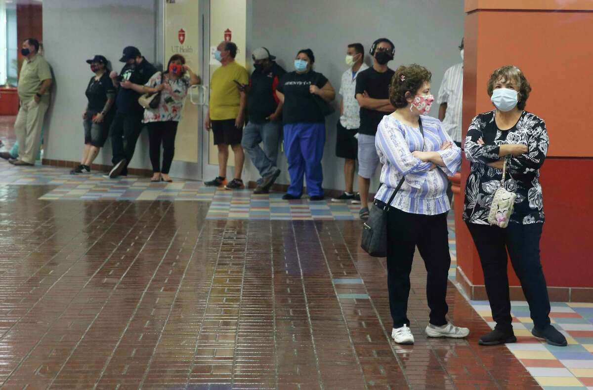 People continue to wait in line, some for several hours, even after the polling site had closed at Wonderland Mall on Tuesday.