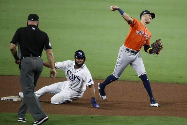 Houston Astros Carlos Correa (1) makes the throw to first after forcing out Tampa Bay Rays Manuel Margot (13) at second on a grounder by Brandon Lowe during the fifth inning of Game 7 of the American League Championship Series at Petco Park Saturday, Oct. 17, 2020, in San Diego. Lowe was safe at first on the fielder's choice. Photo: Karen Warren/Staff Photographer / © 2020 Houston Chronicle