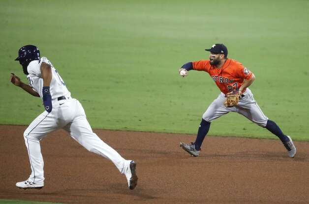 Houston Astros Jose Altuve (27) flips the ball to second to get Tampa Bay Rays Manuel Margot (13) out on a grounder by Brandon Lowe during the fifth inning of Game 7 of the American League Championship Series at Petco Park Saturday, Oct. 17, 2020, in San Diego. Photo: Karen Warren/Staff Photographer / © 2020 Houston Chronicle