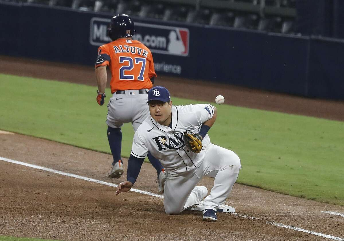 Tampa Bay Rays Ji-Man Choi can't come up with a ball on an infield single by Houston Astros Jose Altuve (27) during the sixth inning of Game 7 of the American League Championship Series at Petco Park Saturday, Oct. 17, 2020, in San Diego.