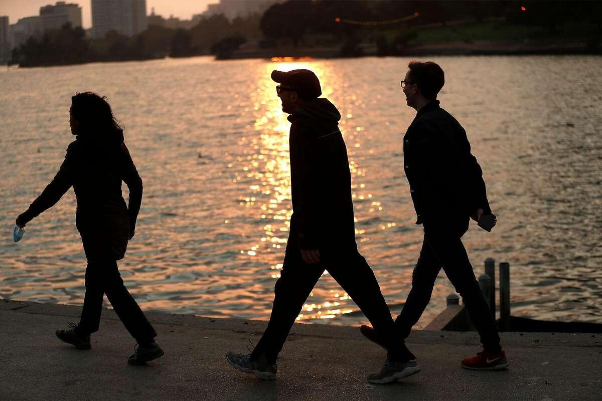 People walk at Lake Merritt in Oakland in October.