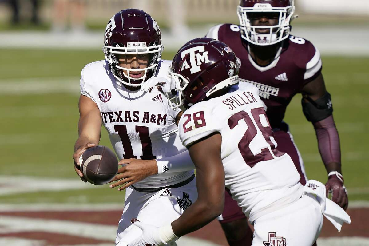 Texas A&M quarterback Kellen Mond hands off to running back Isaiah Spiller in the first half of Saturday's SEC game against Mississippi State in Starkville, Miss.