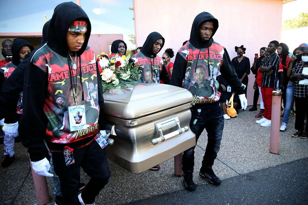 Pallbearers exit Basic Ministry Church with the casket of Aaron Pryor following his funeral service in San Leandro.