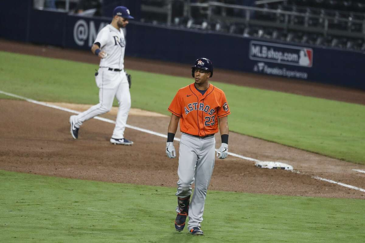 Houston Astros Michael Brantley (23) walks off the field after grounding out to Tampa Bay Rays Brandon Lowe to end the sixth inning of Game 7 of the American League Championship Series at Petco Park Saturday, Oct. 17, 2020, in San Diego.