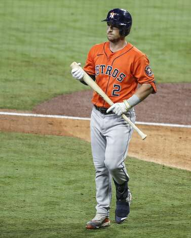 Houston Astros Alex Bregman walks away from the plate after he was struck out by Tampa Bay Rays reliever Pete Fairbanks to end the eighth inning of Game 7 of the American League Championship Series at Petco Park Saturday, Oct. 17, 2020, in San Diego. Photo: Karen Warren/Staff Photographer / © 2020 Houston Chronicle