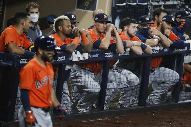 Players in the Houston Astros dugout watch the eighth inning of Game 7 of the American League Championship Series against the Tampa Bay Rays at Petco Park Saturday, Oct. 17, 2020, in San Diego. Photo: Karen Warren/Staff Photographer / © 2020 Houston Chronicle