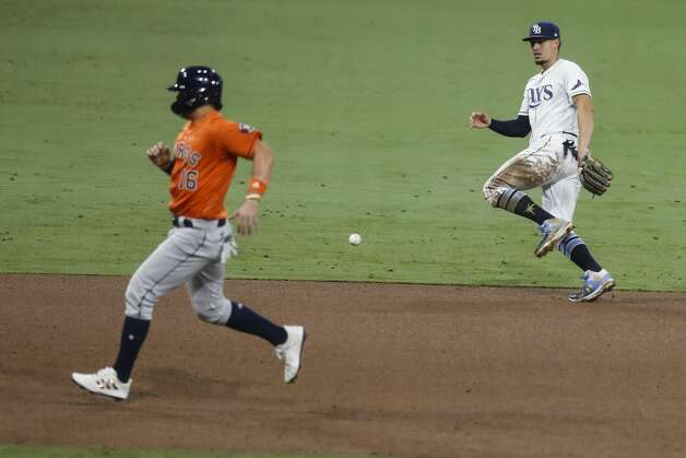 Houston Astros Aledmys Diaz (16) runs to third as the ball gets away from Tampa Bay Rays Willy Adames on a grounder by Jose Altuve during the eighth inning of Game 7 of the American League Championship Series at Petco Park Saturday, Oct. 17, 2020, in San Diego. Photo: Karen Warren/Staff Photographer / © 2020 Houston Chronicle