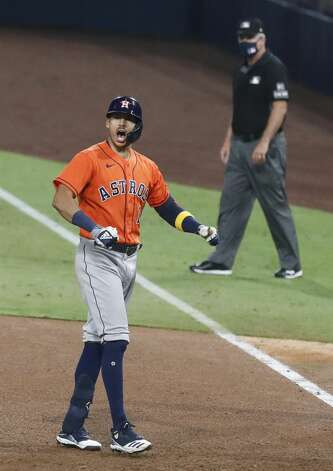 Houston Astros Carlos Correa reacts after hitting a 2-run single against the Tampa Bay Rays during the eighth inning of Game 7 of the American League Championship Series at Petco Park Saturday, Oct. 17, 2020, in San Diego. Photo: Karen Warren/Staff Photographer / © 2020 Houston Chronicle