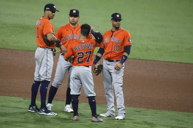 Houston Astros infielders Carlos Correa, Aledmys Diaz, Jose Altuve (27) and Yuli Gurriel (10) stand on the field during a pitching change in the eighth inning of Game 7 of the American League Championship Series at Petco Park Saturday, Oct. 17, 2020, in San Diego. Photo: Karen Warren/Staff Photographer / © 2020 Houston Chronicle
