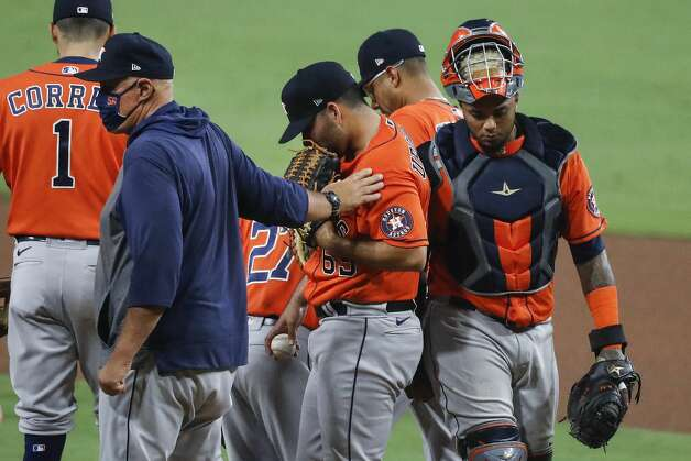 Houston Astros pitching coach Brent Strom places his hand on the shoulder of reliever Jose Urquidy (65) during a mound visit in the seventh inning against the Tampa Bay Rays in Game 7 of the American League Championship Series at Petco Park Saturday, Oct. 17, 2020, in San Diego. Photo: Karen Warren/Staff Photographer / © 2020 Houston Chronicle