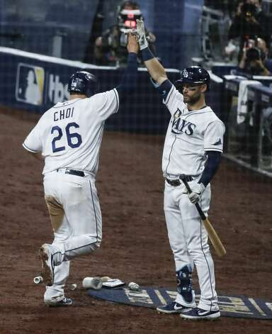 Tampa Bay Rays Ji-Man Choi celebrates after scoring on a sacrifice fly by Mike Zunino during the sixth inning of Game 7 against the Houston Astros in the American League Championship Series at Petco Park Saturday, Oct. 17, 2020, in San Diego. Photo: Karen Warren/Staff Photographer / © 2020 Houston Chronicle