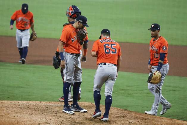 Houston Astros Jose Urquidy (65) walks back to the mound before being relieved during the seventh inning against the Tampa Bay Rays in Game 7 of the American League Championship Series at Petco Park Saturday, Oct. 17, 2020, in San Diego. Photo: Karen Warren/Staff Photographer / © 2020 Houston Chronicle
