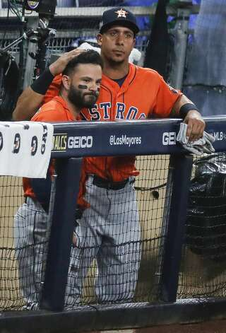 Houston Astros Jose Altuve, left, and Michael Brantley embrace after the Tampa Bay Rays eliminated the Astros in Game 7 of the American League Championship Series at Petco Park Saturday, Oct. 17, 2020, in San Diego. The Rays won Game 7 4-2. Photo: Karen Warren/Staff Photographer / © 2020 Houston Chronicle