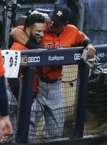 Houston Astros Jose Altuve (27) and Michael Brantley (23) embrace after the Tampa Bay Rays eliminated the Astros in Game 7 of the American League Championship Series at Petco Park Saturday, Oct. 17, 2020, in San Diego. The Rays won Game 7 4-2. Photo: Karen Warren/Staff Photographer / © 2020 Houston Chronicle