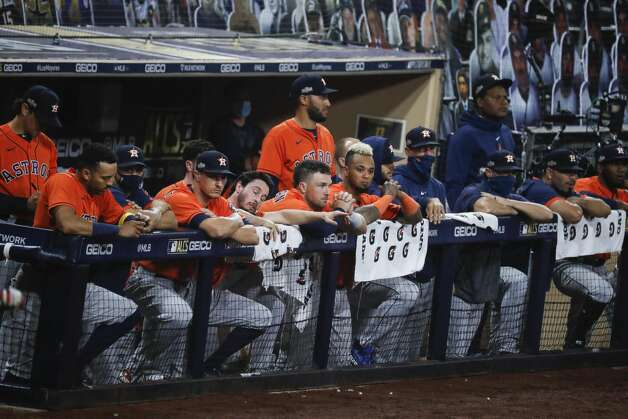 The Houston Astros watch from the dugout as the Tampa Bay Rays take Game 7 with a 4-2 victory in the American League Championship Series at Petco Park Saturday, Oct. 17, 2020, in San Diego. Photo: Karen Warren/Staff Photographer / © 2020 Houston Chronicle