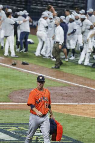 Houston Astros Zack Greinke (21) walks off the field as the Tampa Bay Rays celebrate in the background after the Rays beat the Astros 4-2 to win the American League Championship Series at Petco Park Saturday, Oct. 17, 2020, in San Diego. Photo: Karen Warren/Staff Photographer / © 2020 Houston Chronicle
