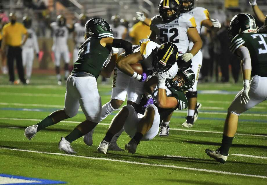 Brennan's Jalin Spells gets into the end zone for one of his two first quarter touchdowns versus Reagan during their game Saturday night at Commalander Stadium. Photo: Robin Jerstad, San Antonio Express-News / **MANDATORY CREDIT FOR PHOTOG AND SAN ANTONIO EXPRESS-NEWS/NO SALES/MAGS OUT?TV